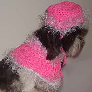 Collette wearing hot pink Poncho and matching hat